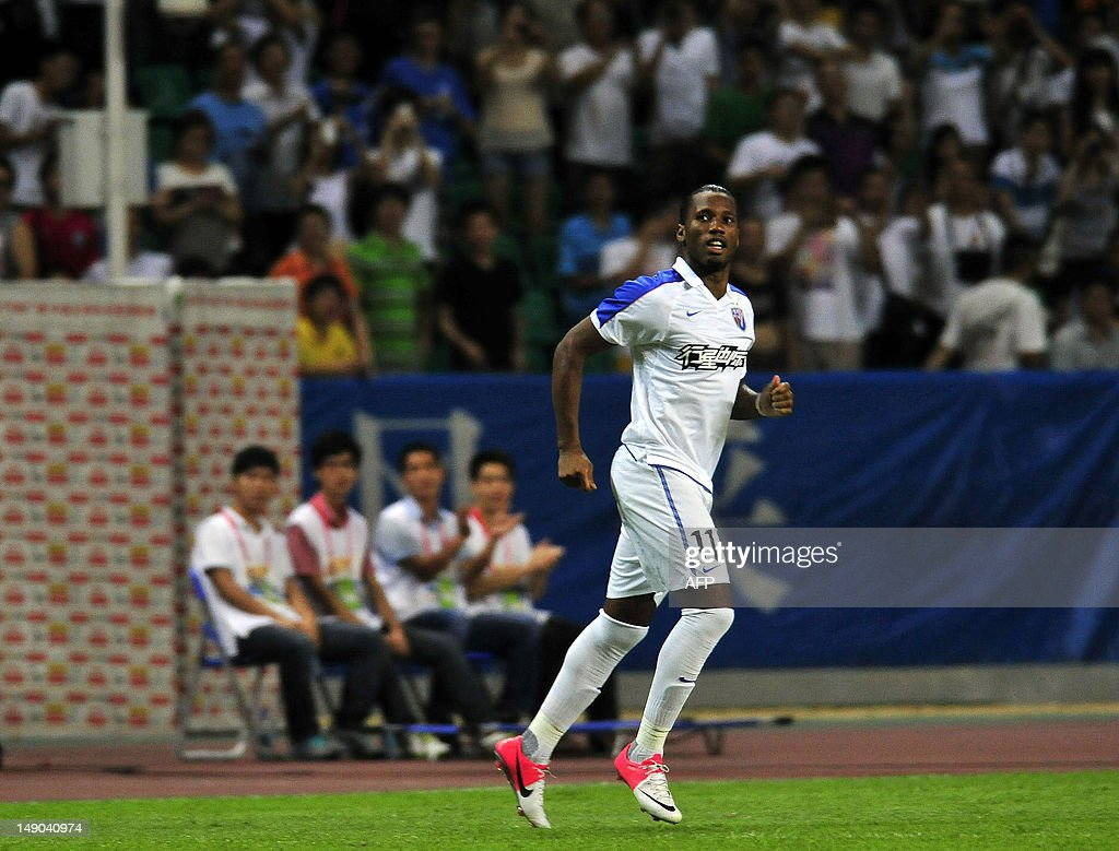 Former Chelsea striker Didier Drogba takes to the pitch for his new team Shanghai Shenhua setting up his sides' equalizer against Guangzhou RF on his...