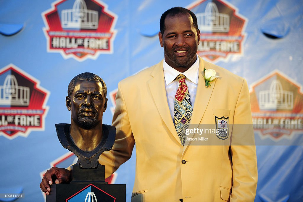 Former Chicago Bears defensive end <a gi-track='captionPersonalityLinkClicked' href=/galleries/search?phrase=Richard+Dent&family=editorial&specificpeople=240277 ng-click='$event.stopPropagation()'>Richard Dent</a> poses with his bust at the Enshrinement Ceremony for the Pro Football Hall of Fame on August 6, 2011 in Canton, Ohio.