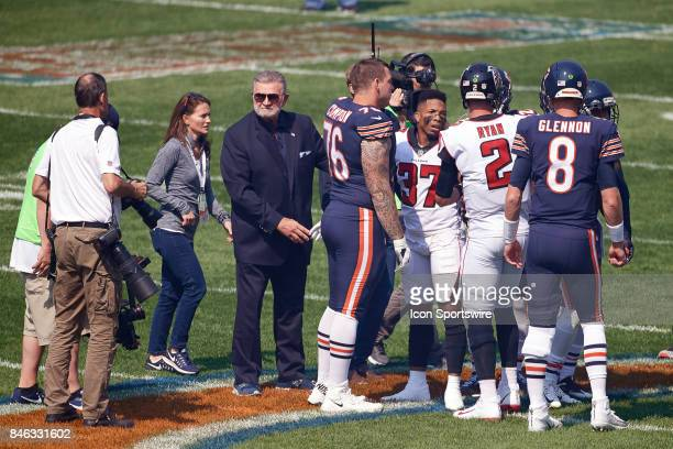 Former Chicago Bears head coach Mike Ditka partakes during the coin toss prior to the start of an NFL football game between the Atlanta Falcons and...