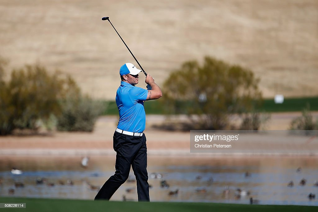 Former Chicago Bears linebacker Brian Urlacher plays his second shot on the 15th hole during the pro-am for the the Waste Management Phoenix Open at TPC Scottsdale on February 3, 2016 in Scottsdale, Arizona.