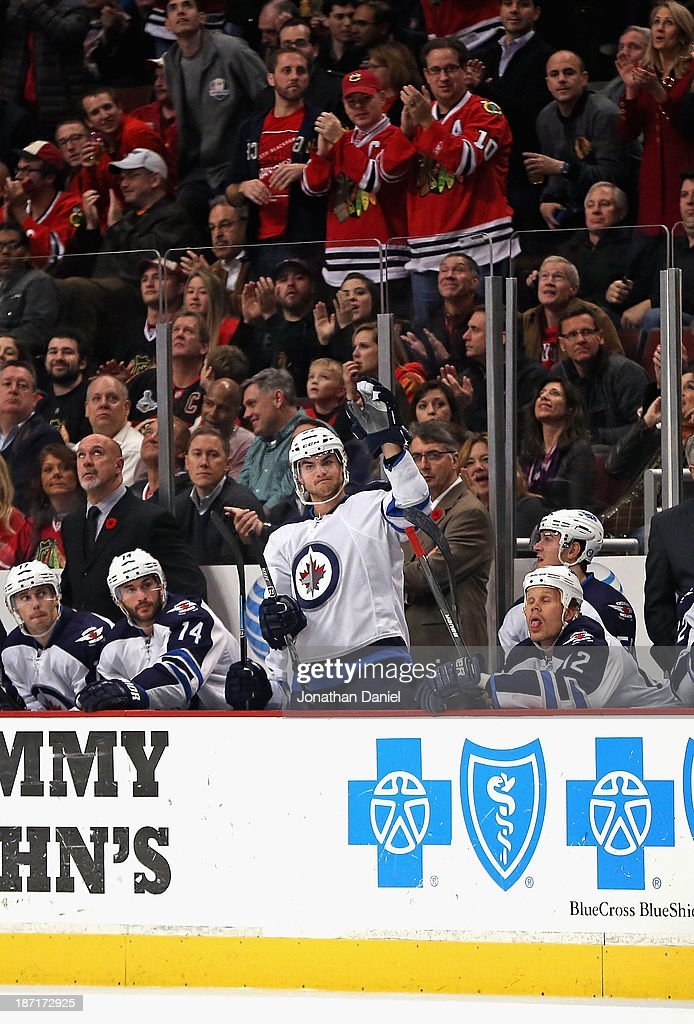 Former Chicago Blackhawk and current the Winnipeg Jet Michael Frolik #67 waves to the crowd after being introduced with a video tribute at the United Center on November 6, 2013 in Chicago, Illinois.