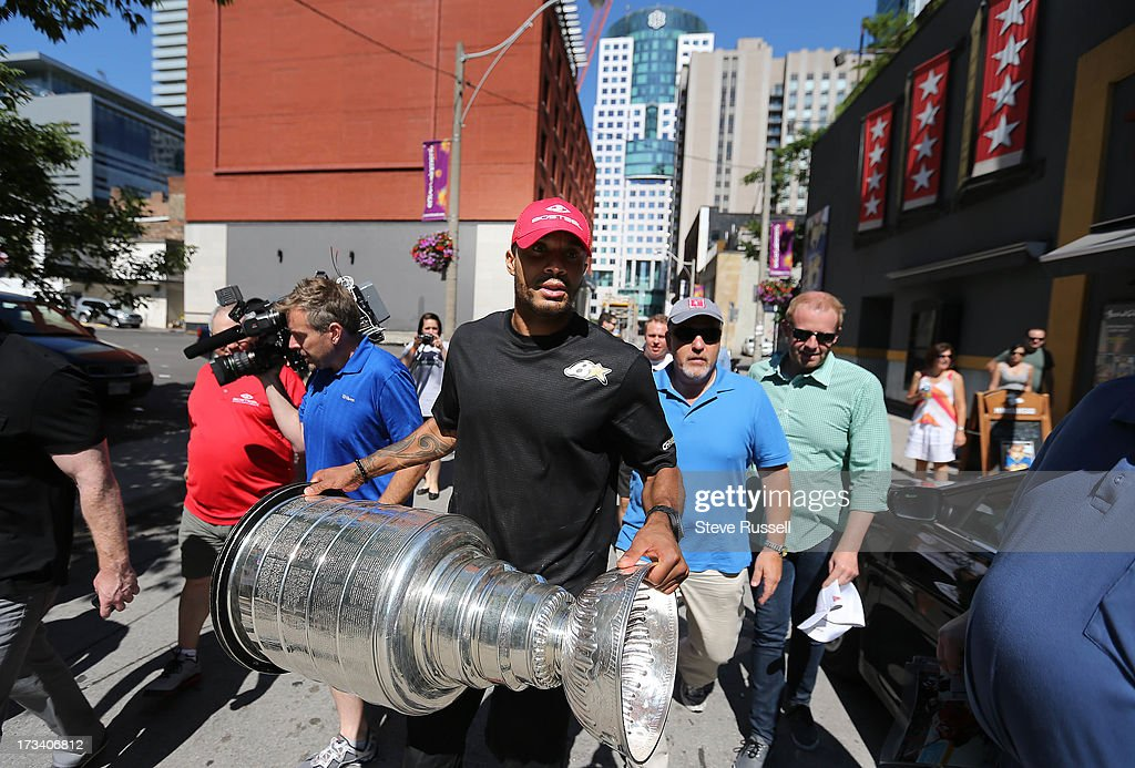 TORONTO, ON- JULY 13 - Former Chicago Blackhawk, now a Flyer, Ray Emery brings the Stanley Cup to Wayne Gretzky's restaurant in Toronto, July 13, 2013.