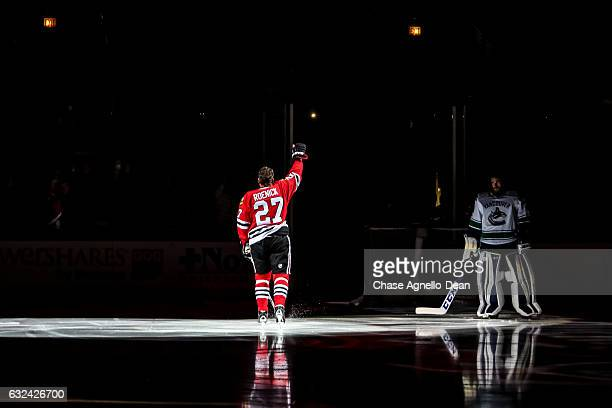 Former Chicago Blackhawks forward Jeremy Roenick is honored during the Blackhawks 'One More Shift' campaign prior to the game against the Vancouver...