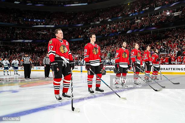 Former Chicago Blackhawks forward Jeremy Roenick stands with the starting lineup during the Blackhawks 'One More Shift' campaign prior to the game...