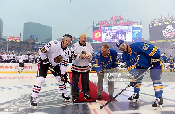 Former Chicago Blackhawks player Bobby Hull and his son former St Louis Blues player Brett Hull prepare to drop the puck for the ceremonial opening...