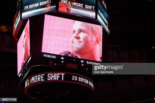 Former Chicago Blackhawks player Brian Bickell who signed a one day contract to retire as a member of the Blackhawks skates the ice as he waves to...
