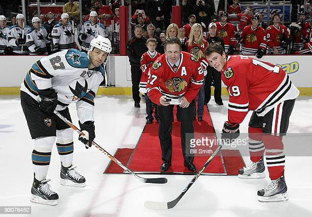 Former Chicago Blackhawks player Jeremy Roenick drops the puck with Jonathan Toews of the Blackhawks and Manny Malhotra of the San Jose Sharks on...