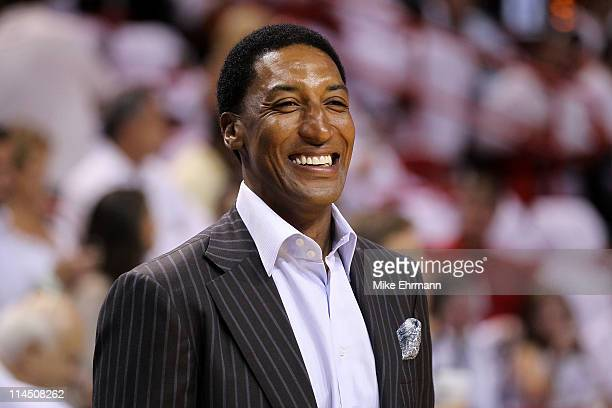 Former Chicago Bull Scottie Pippen looks on as the Chicago Bulls play against the Miami Heat in Game Three of the Eastern Conference Finals during...