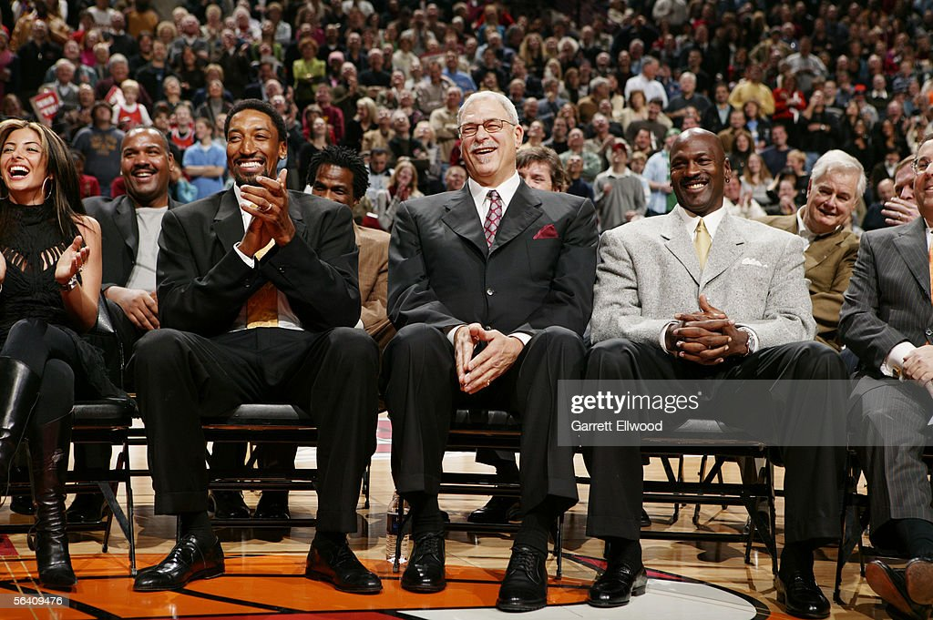 Former Chicago Bulls Scottie Pippen Phil Jackson and Michael Jordan are seen at the retirement ceremony of Scottie Pippen's number during half time...