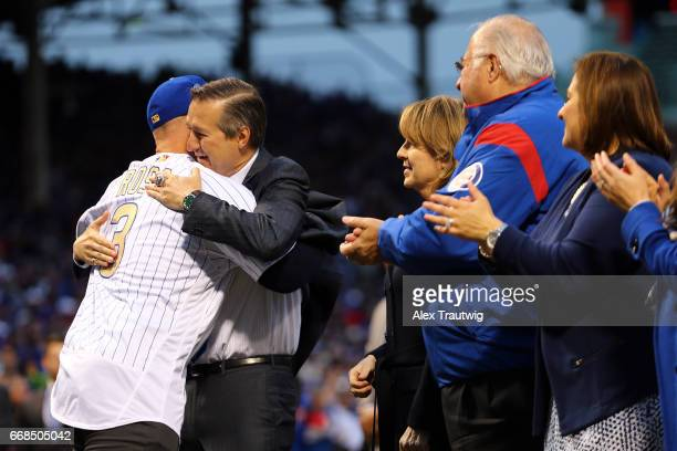 Former Chicago Cubs David Ross hugs owner Tom Ricketts during the World Series ring ceremony ahead of the game between the Los Angeles Dodgers and...