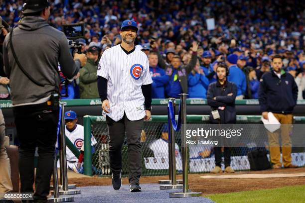 Former Chicago Cubs David Ross takes the field during the World Series ring ceremony ahead of the game between the Los Angeles Dodgers and the...