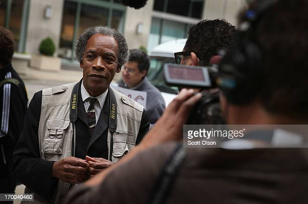 Former Chicago SunTimes photographer Jon Sall shoots video of his former colleague Pulitzer Prize winner John White during a demonstration outside...