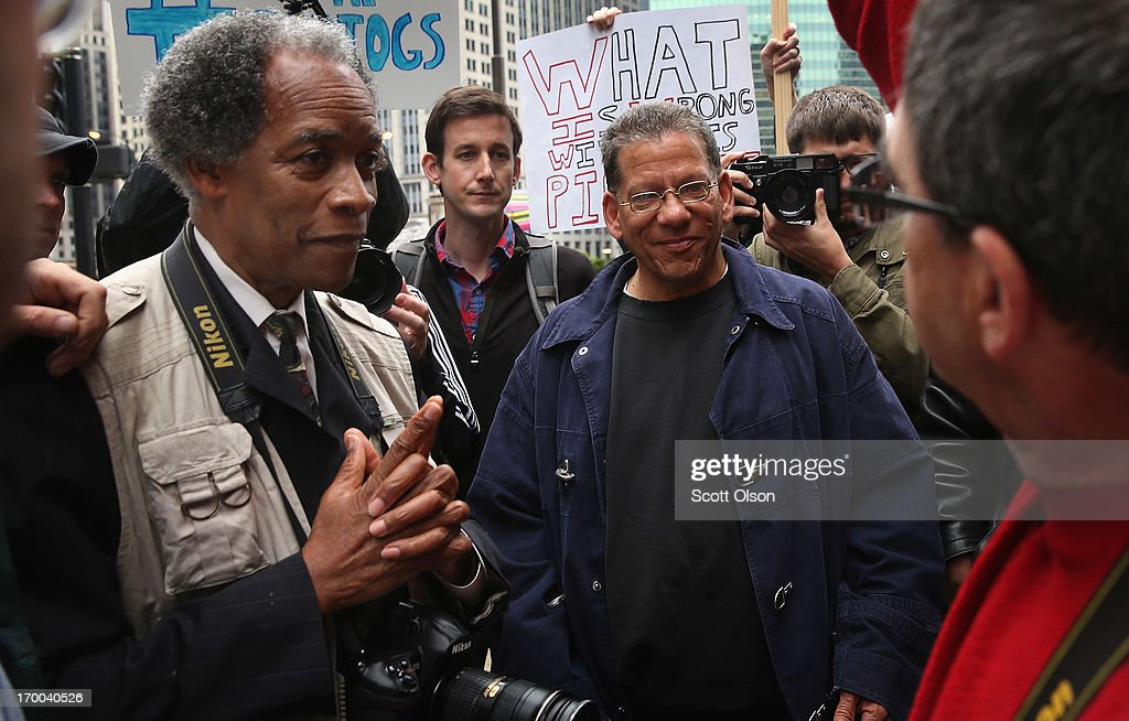 Former Chicago Sun-Times photographers including John White (L), and Brian Jackson (C) participate in a demonstration outside the offices of the Sun-Times on June 6, 2013 in Chicago, Illinois. Union members, reporters, and photographers gathered outside the newspaper's office to protest the company's decision last week to eliminate its 28-member photo staff. The newspaper chain plans to train their reporters to take pictures with iPhones to fill the void.