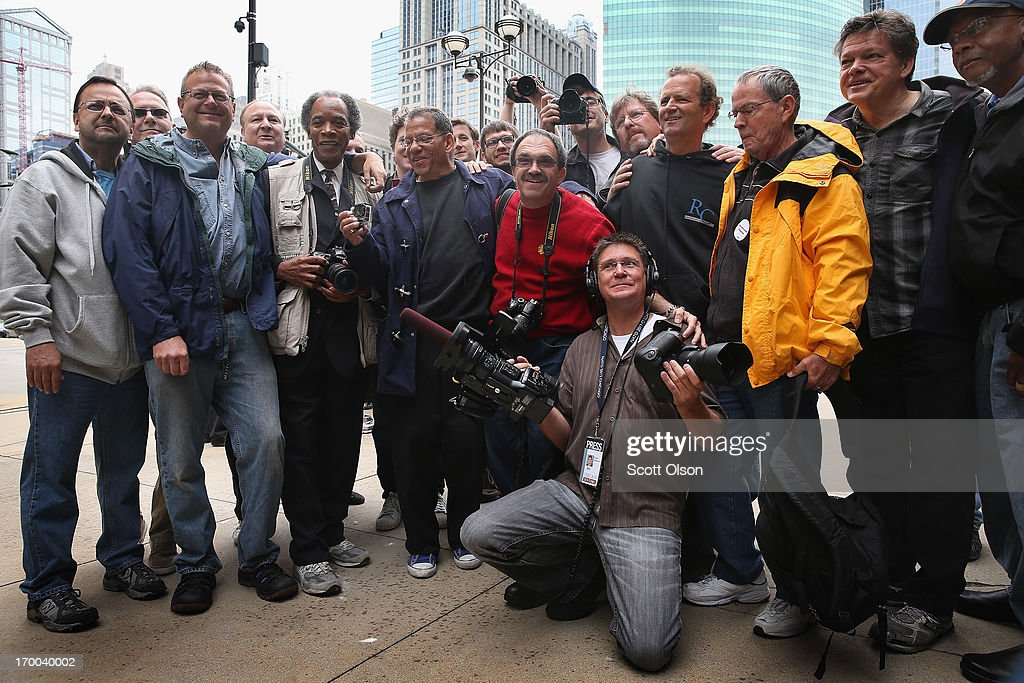 Former Chicago Sun-Times photographers pose for a picture following a demonstration outside the offices of the Sun-Times on June 6, 2013 in Chicago, Illinois. Union members, reporters, and photographers gathered outside the newspaper's office to protest the company's decision last week to eliminate its 28-member photo staff. The newspaper chain plans to train their reporters to take pictures with iPhones to fill the void.