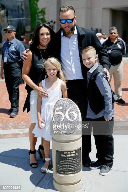 Former Chicago White Sox pitcher Mark Buehrle poses with his son Braden daughter Brooklyn and wife Jamie in front of a monument in his honor...