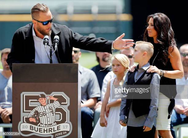 Former Chicago White Sox pitcher Mark Buehrle speaks during the ceremony to retire his number #56 before the game between the Chicago White Sox and...