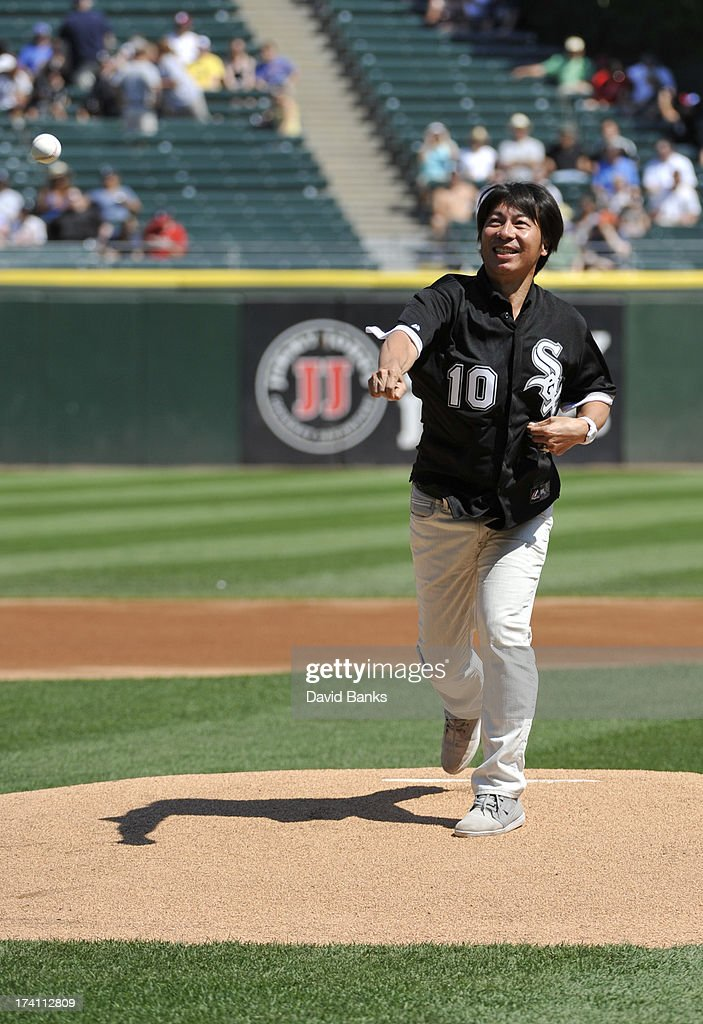 Former Chicago White Sox pitcher Shingo Takatsu throws out the first pitch before the game between the Chicago White Sox and the Atlanta Braves on July 20, 2013 at U.S. Cellular Field in Chicago, Illinois.