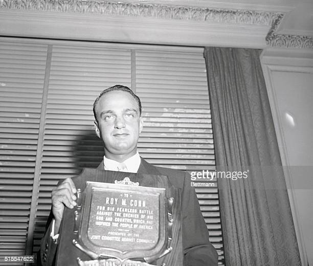 Former chief counsel for the Senate Investigations subcommittee Roy Cohn is shown with the plaque presented to him tonight at the grand ballroom of...