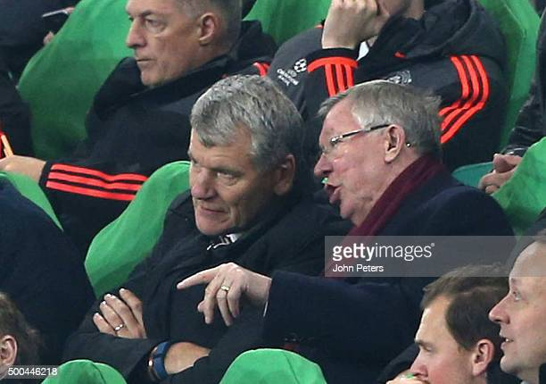 Former Chief Executive David Gill and former manager Sir Alex Ferguson of Manchester United watch from the directors' box during the UEFA Champions...