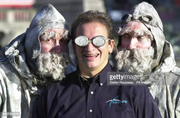 Former Chief Executive of the Millennium Dome PY Gerbeau with two icey explorers in London's Trafalgar Square PY was launching 'Xscape' his new...
