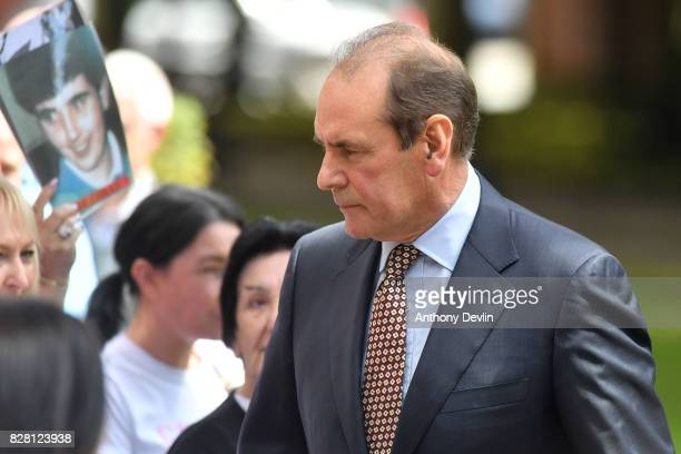 Former chief inspector of South Yorkshire Police Sir Norman Bettison walks passes the families of Hillsborough victims as he arrives at Warrington...