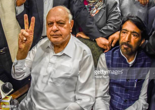 Former Chief Minister and National Conference patron Farooq Abdullah flashes victory sign at his party headquarters after winning the elections of...
