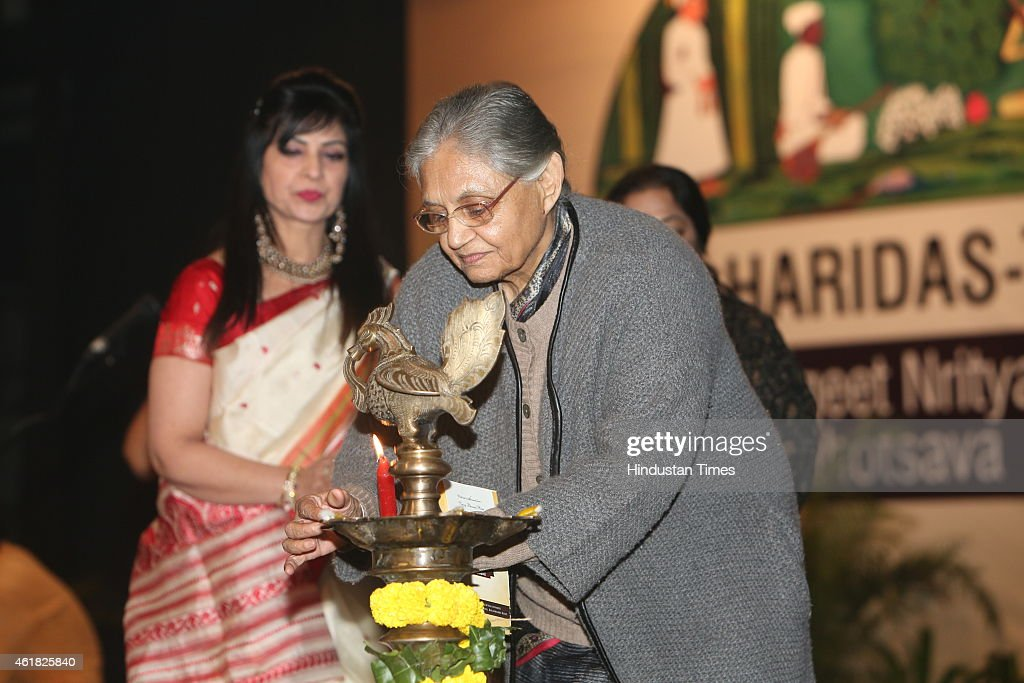 Former chief minister of Delhi <a gi-track='captionPersonalityLinkClicked' href=/galleries/search?phrase=Sheila+Dikshit&family=editorial&specificpeople=728110 ng-click='$event.stopPropagation()'>Sheila Dikshit</a> lighting the inaugurational lamp duirng Swami Haridas Tansen Sangeet Nritya Mahotsavon at FICCI Auditorium on January 9, 2015 in New Delhi, India. The three day event organized by Bharatiya Sangeet Sadan and Shri Ram Centre For Performing Arts includes performances by exponents in the field of music and dance.
