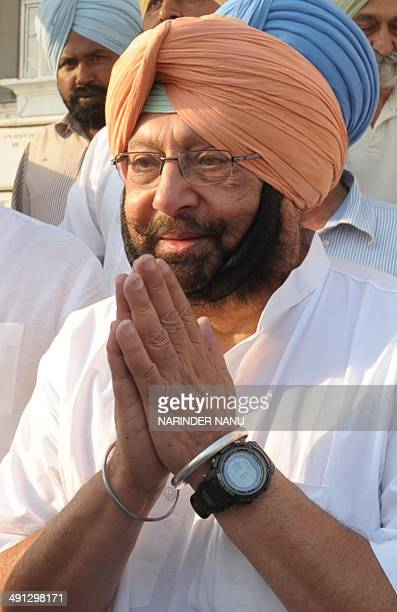 Former chief minister of the Indian state of Punjab and Congress Party candidate for Amritsar's parliamentary seat Amarinder Singh gestures as he...