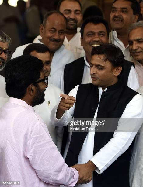 Former Chief Minister of Uttar Pradesh and President of Samajwadi Party Akhilesh Yadav meets Shiv Sena Lok Sabha MP Ravindra Gaikwad with other MPs...