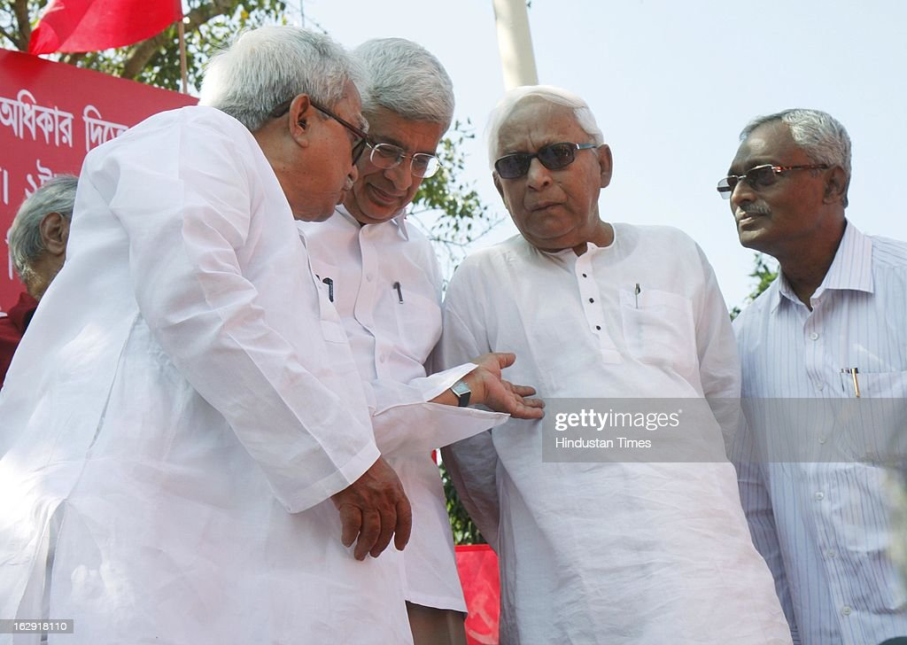Former Chief Minister of West Bengal Buddhadeb Bhattacharya (C), CPI (M) General Secretary Prakash Karat and Biman Bose West Bengal state chief of CPI (M) flagging of the The Eastern Sangharsh Sandesh Jatha of Communist Party of India (Marxist) at Rani Rashmoni Road on March 1, 2013 in Kolkata, India. Starting from West Bengal and led by Party General Secretary Prakash Karat , this Jatha will travel through the states of Jharkhand, Bihar, Uttar Pradesh, Haryana and culminate in Delhi on March 14, 2013. The Jatha will apprise the masses about the alleged anti-people policies of the UPA regime.