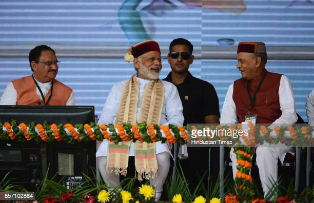Former Chief Minister Prem Kumar Dhumal and Prime Minister Narendra Modi during a BJP Abhar Rally at Luhnu ground on October 3 2017 in Bilaspur India...