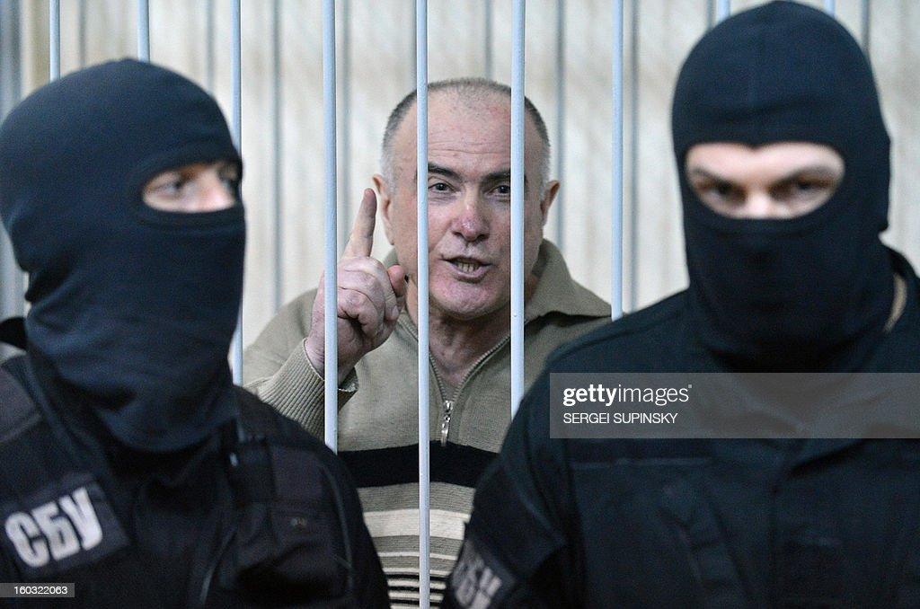 Former chief of the external surveillance department of the Ukrainian Interior Ministry Oleksiy Pukach says that the former president Leonid Kuchma and the former speaker Volodymyr Lytvyn must to be together with him in the cage, after the verdict reading of his trial for the murder of opposition journalist Georgy Gongadze in 2000, on January 29, 2013 at Kiev district court.