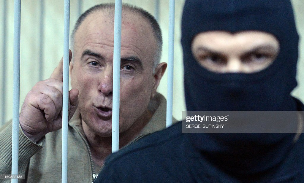 Former chief of the external surveillance department of the Ukrainian Interior Ministry Oleksiy Pukach smiles as says that the former president Leonid Kuchma and the former speaker Volodymyr Lytvyn must to be together with him in the cage, after the verdict reading of his trial for the murder of opposition journalist Georgy Gongadze in 2000, on January 29, 2013 at Kiev district court. Ukraine jails the ex-top official for life over journalist murder .