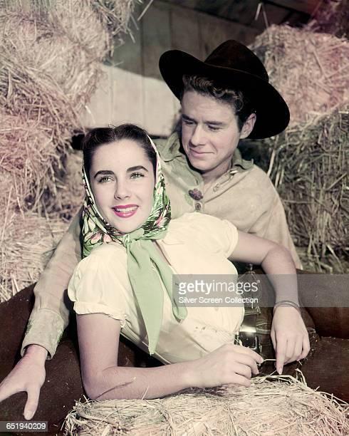 Former child actors Elizabeth Taylor and Jackie Cooper in a hay barn circa 1950