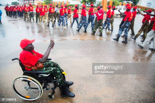 A former child soldier and member of the Red Army Foundation pictures his fellow colleagues on July 9 during a march on the streets of Juba South...