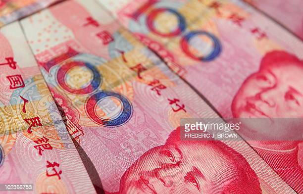 Former Chinese Communist Party leader Mao Zedong's image is seen in an illustration display of Chinese currency 100 Yuan notes in Beijing on June 21...