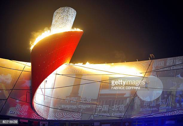 Former Chinese Olympic gymnast Li Ning lights the Olympic torch during the opening ceremony of the 2008 Beijing Olympic Games in Beijing on August 8...