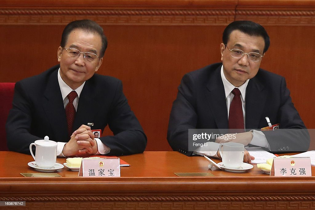 Former Chinese premier Wen Jiabao (L) and China's new Premier Li Keqiang (R) attend the closing session of the National People's Congress (NPC) at the Great Hall of the People on March 17, 2013 in Beijing, China. China's newly-elected president Xi Jinping pledged Sunday to resolutely fight against corruption and other misconduct in all manifestations.