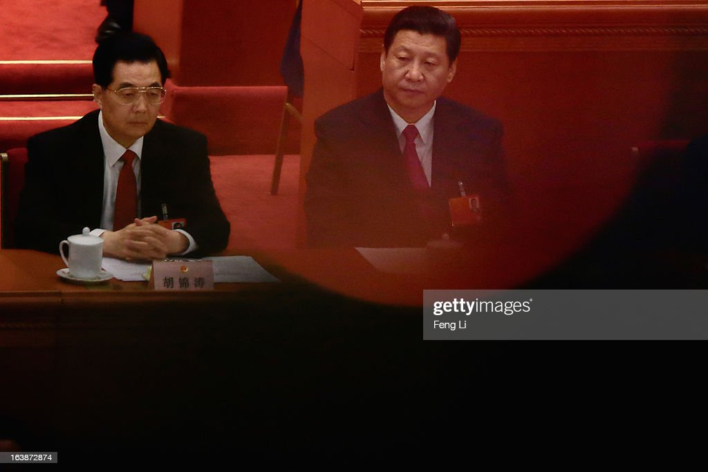 Former Chinese president Hu Jintao (L) and newly-elected Chinese President Xi Jinping (R) attend the closing session of the National People's Congress (NPC) at the Great Hall of the People on March 17, 2013 in Beijing, China. China's newly-elected president Xi Jinping pledged Sunday to resolutely fight against corruption and other misconduct in all manifestations.