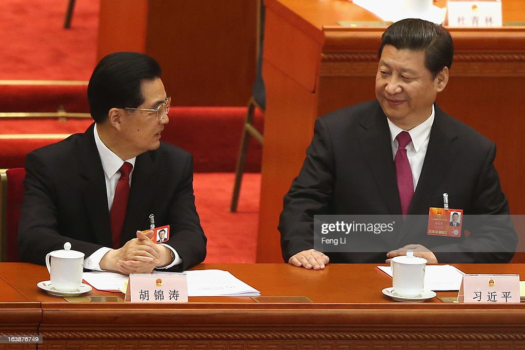 Former Chinese president <a gi-track='captionPersonalityLinkClicked' href=/galleries/search?phrase=Hu+Jintao&family=editorial&specificpeople=203109 ng-click='$event.stopPropagation()'>Hu Jintao</a> (L) and newly-elected Chinese President <a gi-track='captionPersonalityLinkClicked' href=/galleries/search?phrase=Xi+Jinping&family=editorial&specificpeople=2598986 ng-click='$event.stopPropagation()'>Xi Jinping</a> (R) attend the closing session of the National People's Congress (NPC) at the Great Hall of the People on March 17, 2013 in Beijing, China. China's newly-elected president <a gi-track='captionPersonalityLinkClicked' href=/galleries/search?phrase=Xi+Jinping&family=editorial&specificpeople=2598986 ng-click='$event.stopPropagation()'>Xi Jinping</a> pledged Sunday to resolutely fight against corruption and other misconduct in all manifestations.