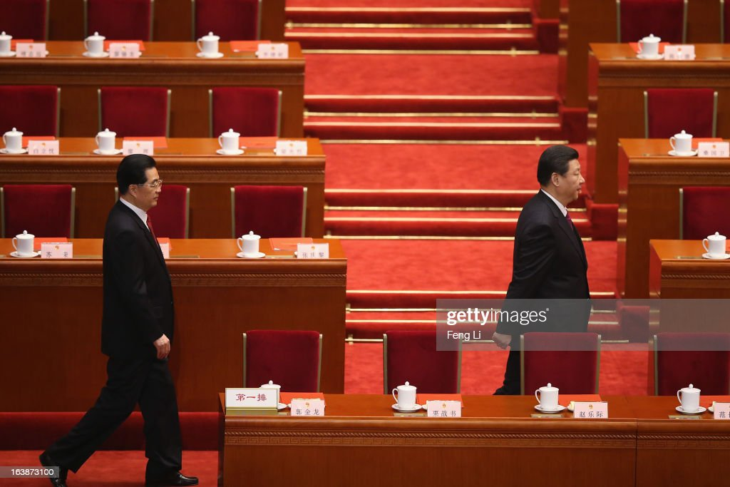 Former Chinese president Hu Jintao (L) follows the newly-elected Chinese President Xi Jinping (R) to arrive the closing session of the National People's Congress (NPC) at the Great Hall of the People on March 17, 2013 in Beijing, China. China's newly-elected president Xi Jinping pledged Sunday to resolutely fight against corruption and other misconduct in all manifestations.
