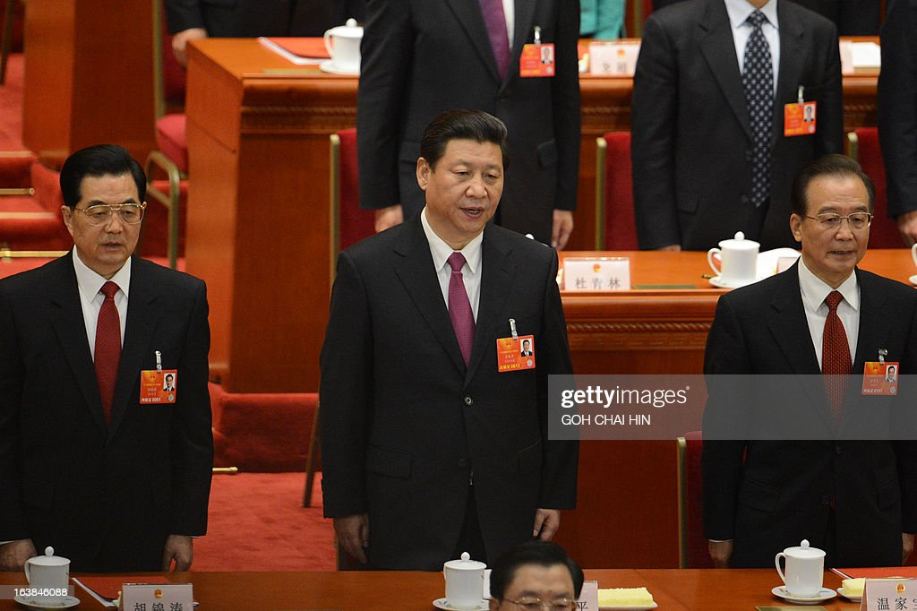 Former Chinese president Hu Jintao, newly-elected Chinese President Xi Jinping and former premier Wen Jiabao sing the national anthem at the closing session of the National People's Congress (NPC) at the Great Hall of the People in Beijing on March 17, 2013. Xi said he would fight for a 'great renaissance of the Chinese nation', in his first speech as head of state of the world's most populous country. AFP PHOTO/GOH CHAI HIN