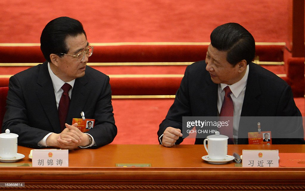 Former Chinese President Hu Jintao (L) talks to newly-elected President Xi Jinping after the election of the new president of China during the 12th National People's Congress (NPC) in the Great Hall of the People in Beijing on March 14, 2013. Chinese Communist Party leader Xi Jinping was named president of the world's most populous country after a vote at its parliamentary meeting in Beijing. AFP PHOTO /GOH CHAI HIN