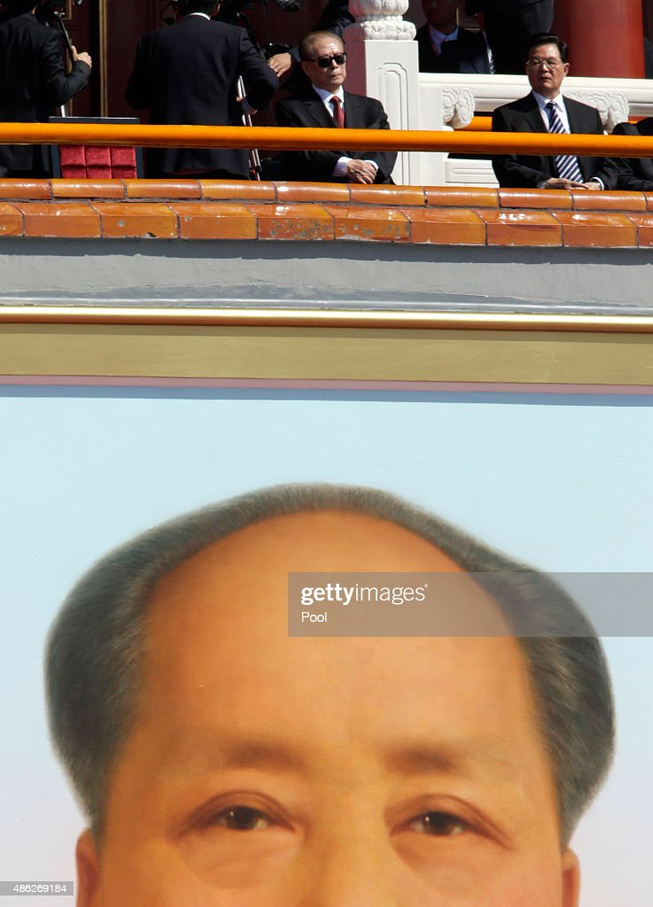 Former Chinese President Jiang Zemin and former Chinese President Hu Jintao are seen above of a portrait of late chairman Mao Zedong as they attend a...