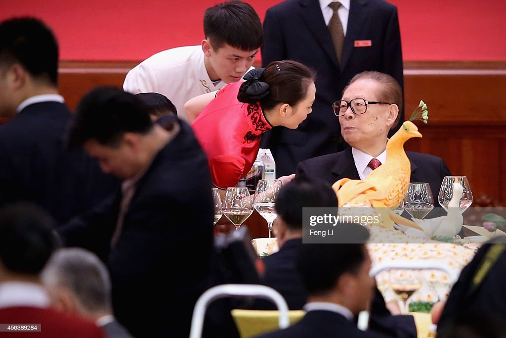 Former Chinese President Jiang Zemin attends the National Day reception marking the 65th anniversary of the founding of the People's Republic of...