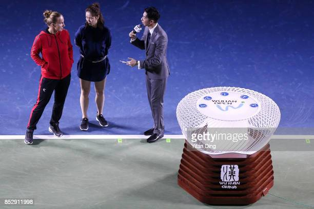 Former Chinese tennis player Li Na and tennis player Svetlana Kuznetsova react during the opening ceremony on Day 1 of 2017 Dongfeng Motor Wuhan Open...