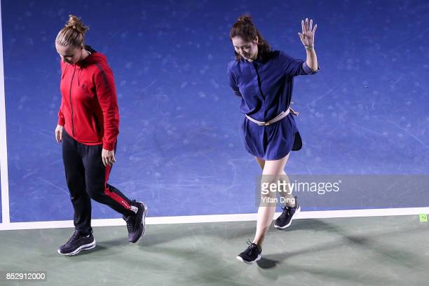 Former Chinese tennis player Li Na and tennis player Svetlana Kuznetsova wave to the audience during the opening ceremony on Day 1 of 2017 Dongfeng...