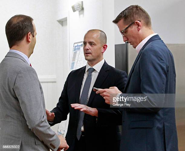 Former CIA agent Evan McMullin campaign worker Peter Watkins and chief strategist Joel Sbarby talk before McMullin announced his presidential...