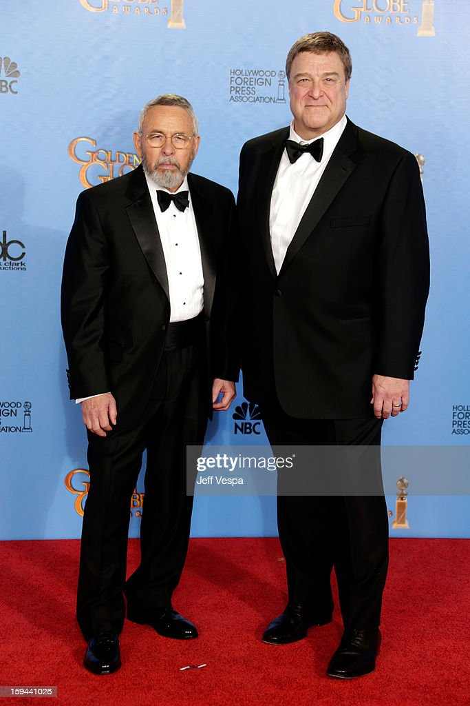 Former CIA agent Tony Mendez (L) and actor John Goodman pose in the press room at the 70th Annual Golden Globe Awards held at The Beverly Hilton Hotel on January 13, 2013 in Beverly Hills, California.