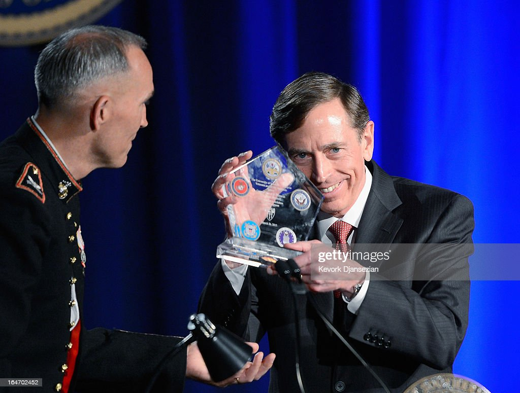 Former CIA director and retired four-star general <a gi-track='captionPersonalityLinkClicked' href=/galleries/search?phrase=David+Petraeus&family=editorial&specificpeople=175826 ng-click='$event.stopPropagation()'>David Petraeus</a> receives a plaque of appreciation after making his first public speech since resigning as CIA director at University of Southern California dinner for students Veterans and ROTC students on March 26, 2013 in Los Angeles, California. Petraeus apologized in his speech for his actions that lead to him resigning from the CIA.